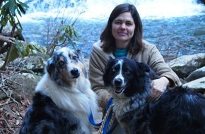 Photo of Dr Angela Barry with two dogs