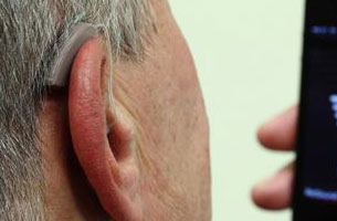 Hearing Aid In Hand