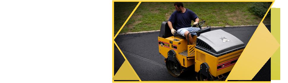 Man doing asphalt maintenance