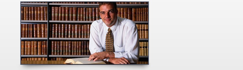 Attorney reading a book on law