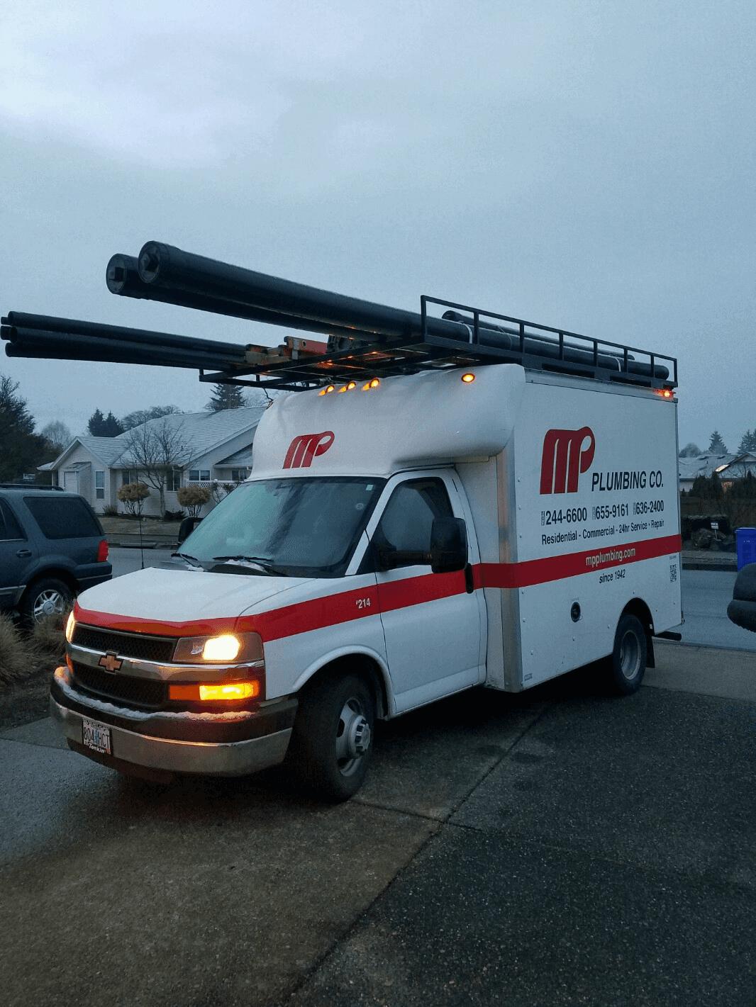M P Plumbing Truck