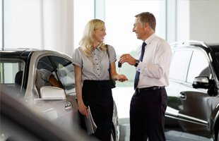 Salesman, woman and automobiles