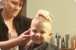 Kid having a hair cut