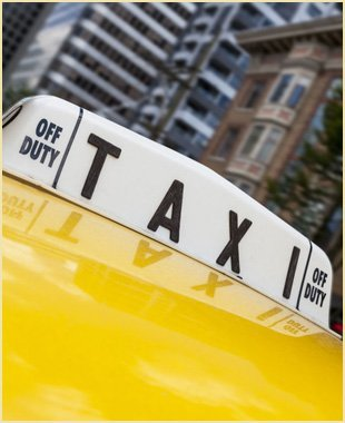 Close up of roof sign on moving New York City yellow taxi cab
