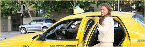 Woman getting into a taxi cab