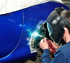 Man have spot welding on the car