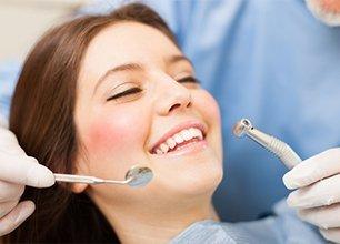 Smiling woman having her teeth whitening