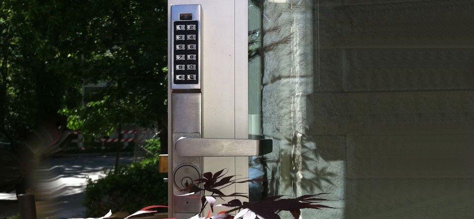 Electronic pushbutton lock on aluminum storefront door