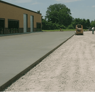Concrete driveway in front of a building
