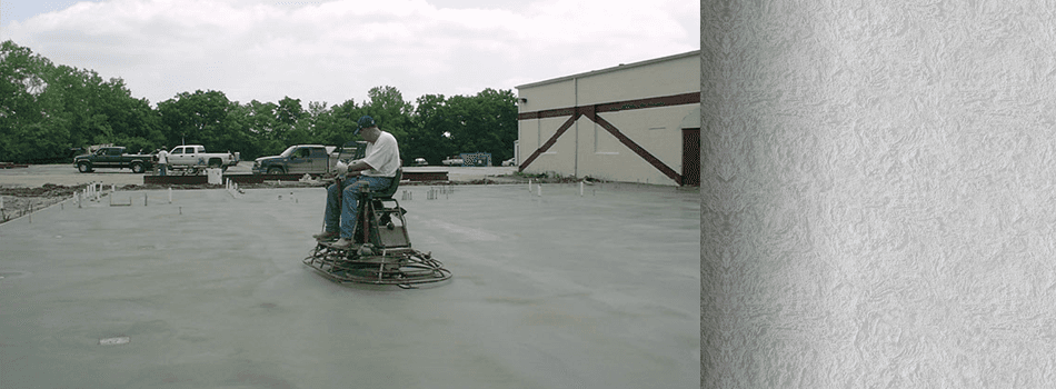 Man smoothing the surface with a  trowelling machine