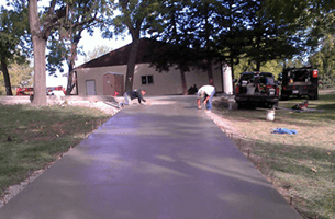 Concrete driveway in front of a house