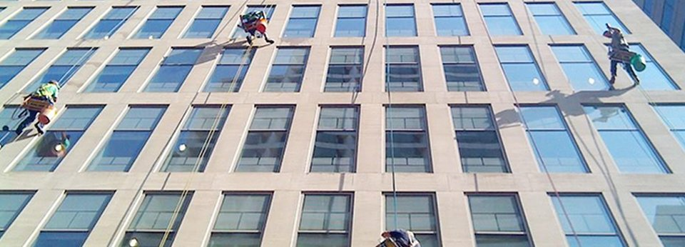 Window cleaners up on scaffold