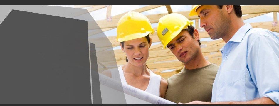 Men and woman looking at blueprint