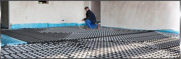 Man installing heating system.