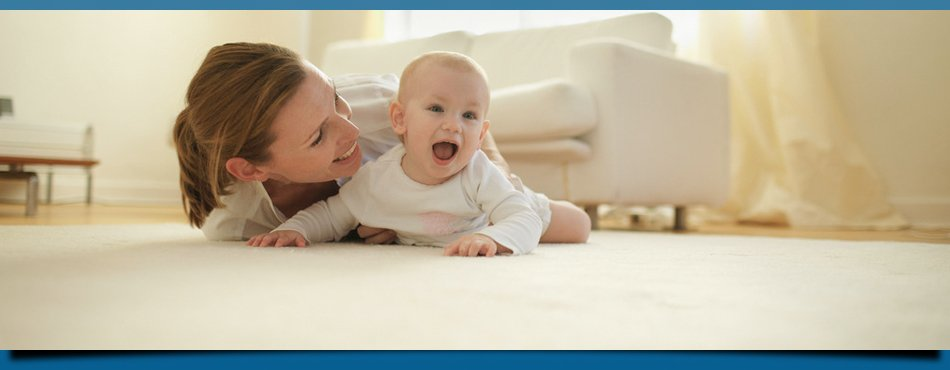 Mother and child playing on carpet