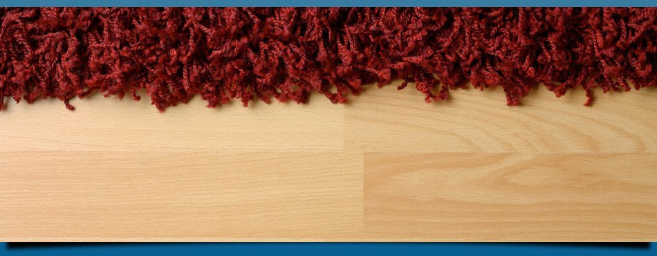 Red carpet on wooden flooring