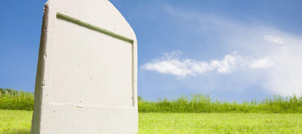 Clean gravestone in greenfields