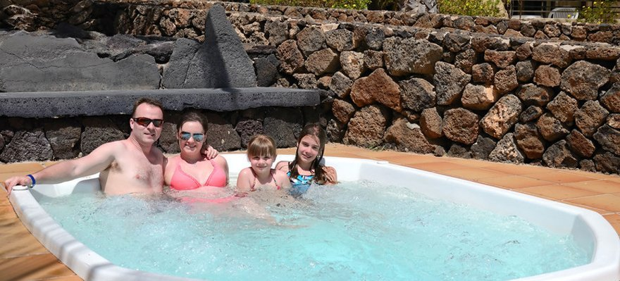 Family on hot tub