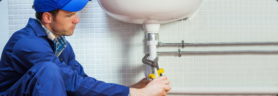Plumber fixing bathroom sink