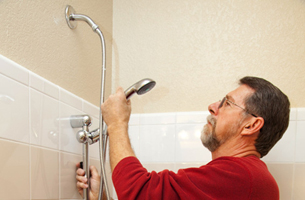 Plumber working on shower heads