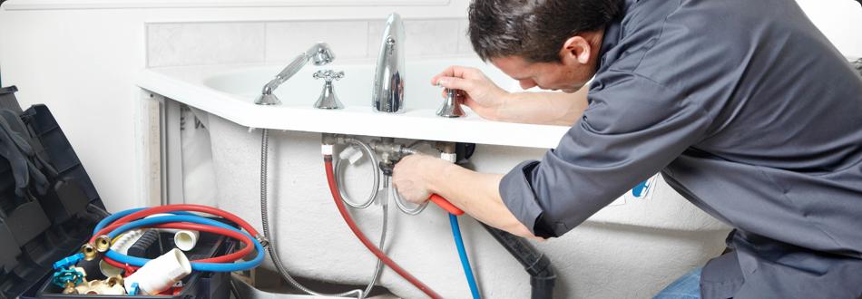 Plumber working on bath tub