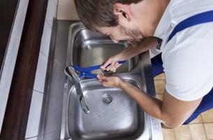 Plumber fixing sink