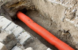 Orange pipe under the ground