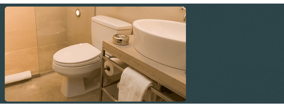 A plumber is repairing a damaged bathroom sink