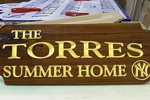 The Torres Summer Home sign