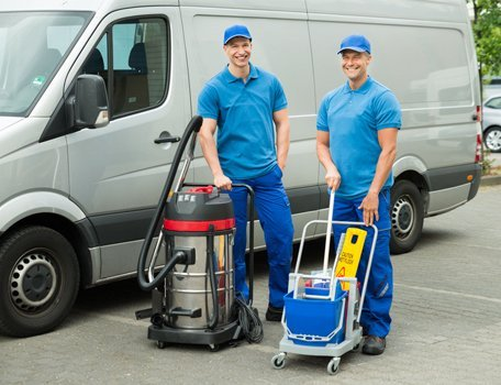 male cleaners smiling