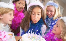 Girl kid blowing her cake on party
