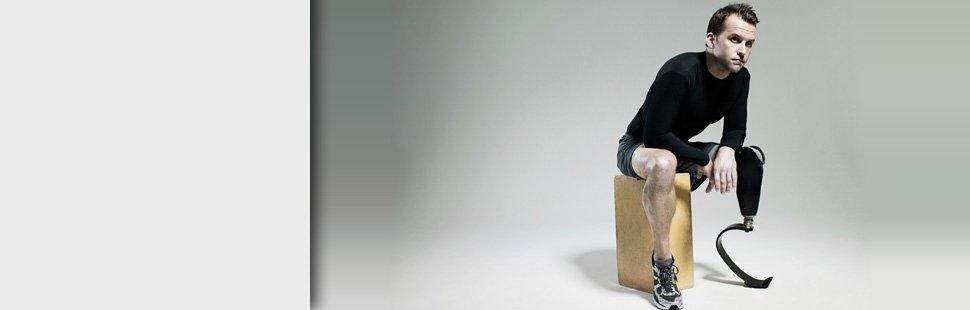 Man with prosthetic leg sitting
