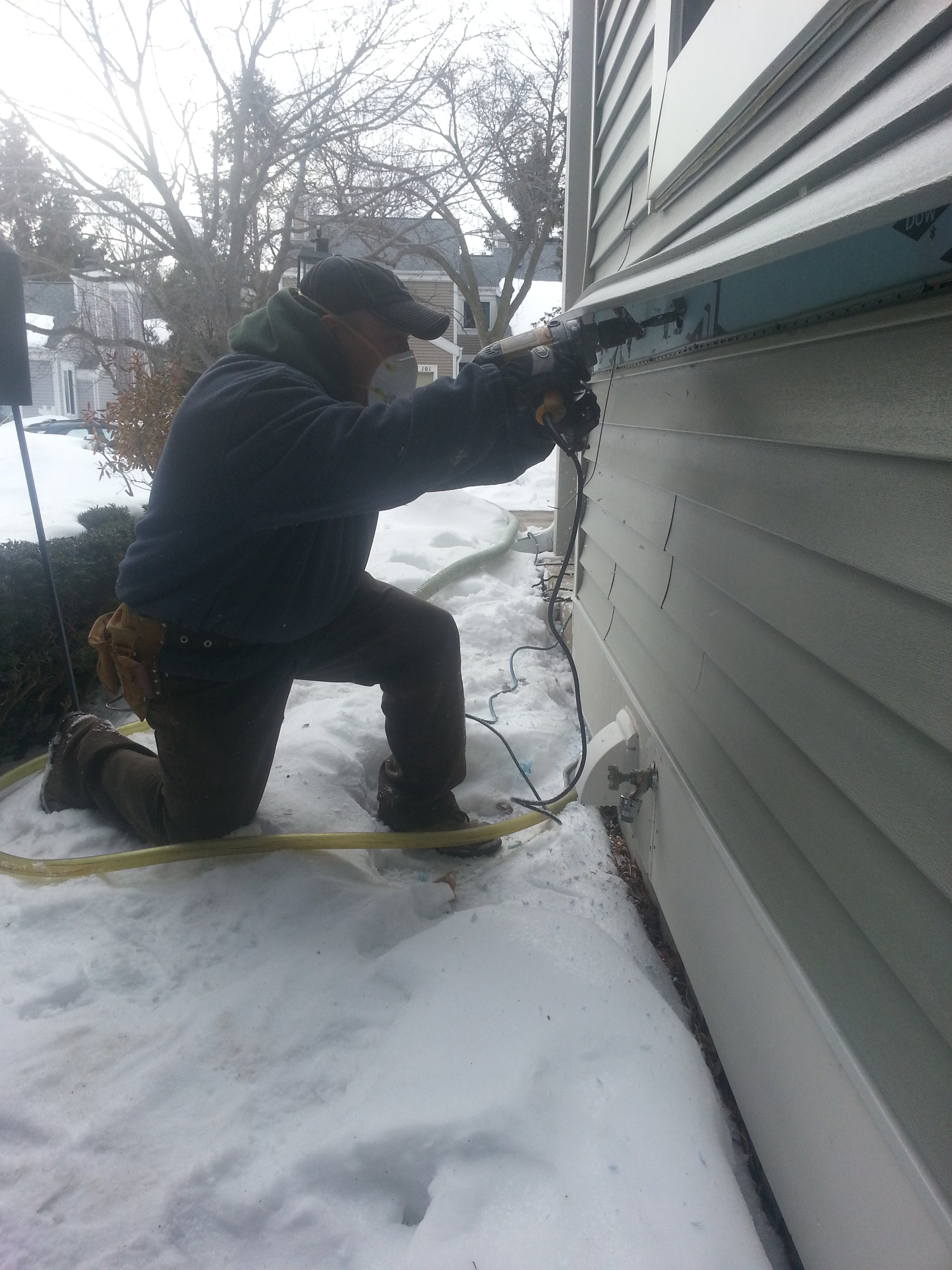 Accessing exterior wall cavities to insulate