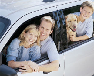 A View Of Family Looking Out Of Window In Car