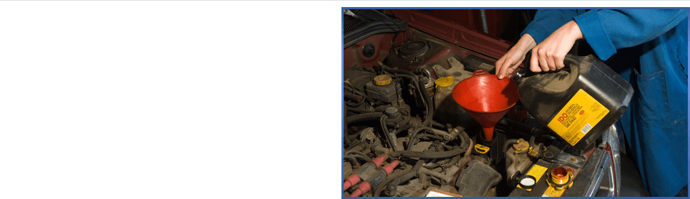 Man putting oil on car engine