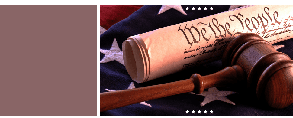 Gavel and papers stood on the American flag