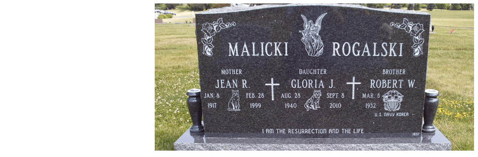 Granite memorial mark with angel image engraved on the top