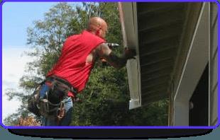 A man fixing a gutter