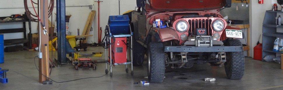 mechanic fixing auto part