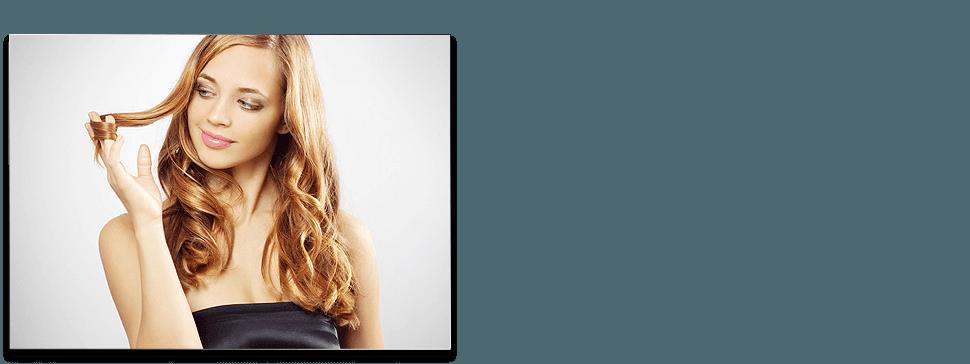 Blonde lady curling hair