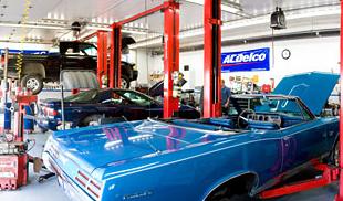 Blue vintage car being repaired