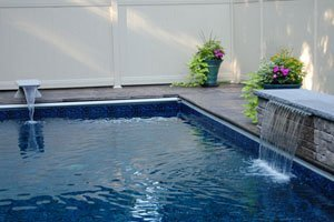 customized swimming pool with water feature