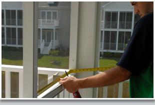 Man installing glass window