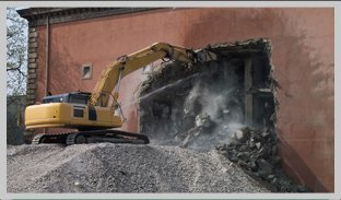 Demolitioning old concrete warehouse