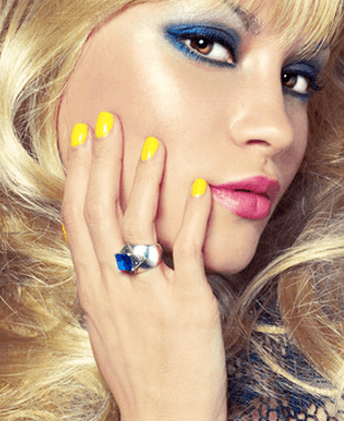 A lady with yellow colored finger nails