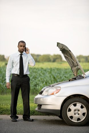 Man in front of stalled car