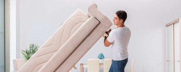man moving out furniture