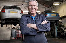 Happy mechanic in a garage shop