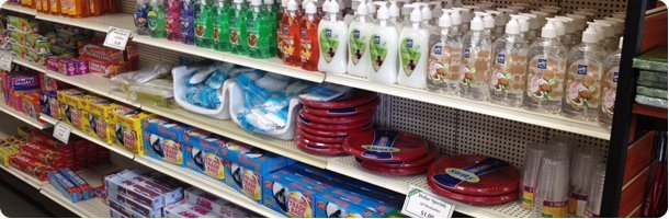 Cleaning supplies in different colors with blue gradient background