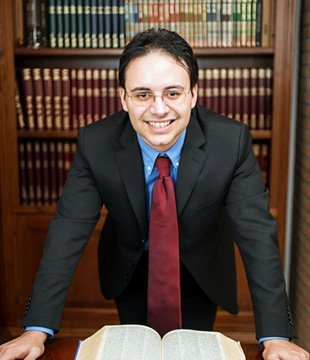 Lawyer leaning on a table